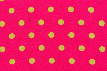 Close up of yellow dot over pink Polka dot fabric background and texture. Top quality. Stock Photo