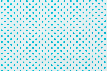 Close up of blue polka dots in white fabric. Stock Photo