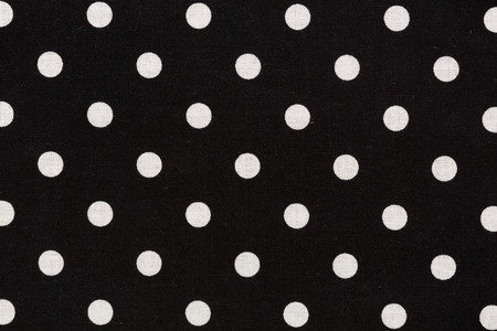 Close up of black and white dots fabric background.