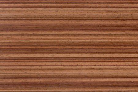 Walnut veneer, natural wooden surface.