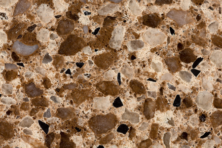 touchstone: Close up of artificial marble granite stone textured background.