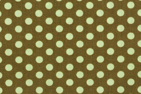 Close up of biege with light green polka dots background pattern. Stock Photo