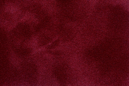 The surface of the red velvet cover on the poker table. High quality image. Archivio Fotografico