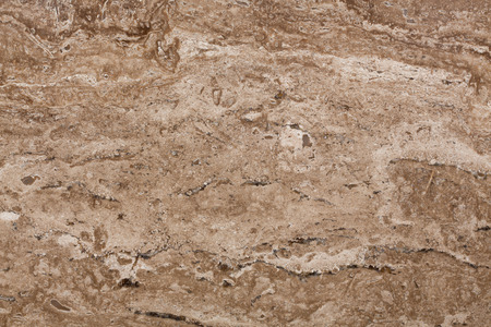 the heterogeneity: Travertine classic warm beige color with a pronounced banding and heterogeneity of pattern. High resolution photo.