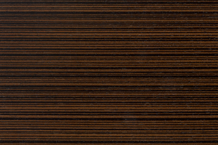 Dark ebony veneer, natural wooden background on macro. Extremely high resolution photo.