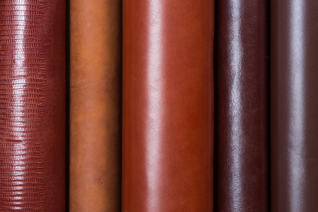 Close up of beige leather rolls in vertical lines. High resolution photo. Stock Photo