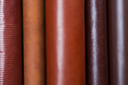 Close up of stocks of a beige leather are necessary for manufacture. High resolution photo. Stock Photo