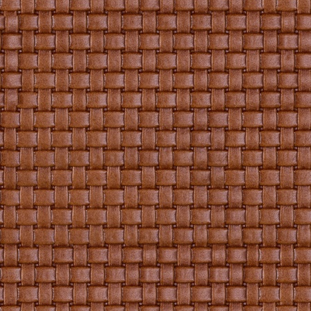 Vintage natural brown braided leather texture. Seamless square background, tile ready. High resolution photo.