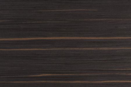 Expensive ebony. Dark wood background. Extremely high resolution photo.