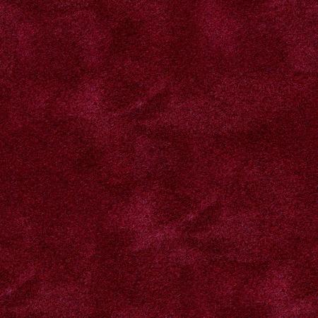 Het oppervlak van de rode fluwelen hoes op de pokertafel. Naadloze vierkante achtergrond, klaar tegel. Afbeelding van hoge kwaliteit.