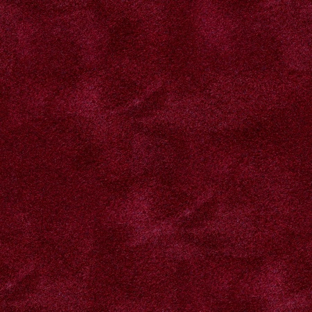 The surface of the red velvet cover on the poker table. Seamless square background, tile ready. High quality image.