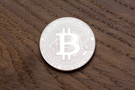global investing: Digital currency physical silver bitcoin on the wood. Close-up photo. Stock Photo