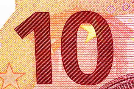 dept: Ten euro banknote in macro shot. High resolution photo.