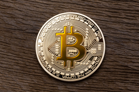 silver coins: Golden yellow bitcoin on wooden background. High resolution photo. Stock Photo
