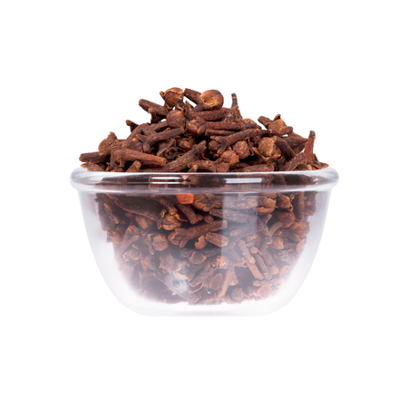 Dried cloves in saucepan on white background. High resolution photo. Stock Photo