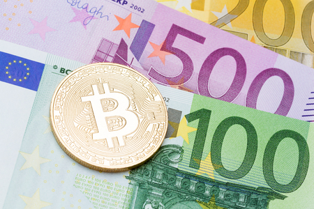 silver coins: Golden Bitcoins close-up on euro currency background. High resolution photo.