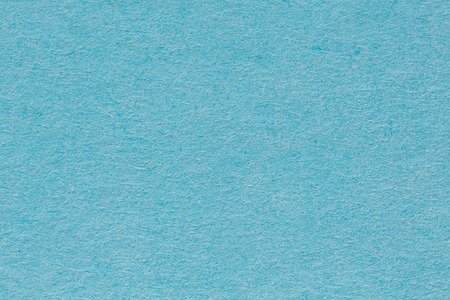 Blue paper background. Space for text or image. High resolution photo.