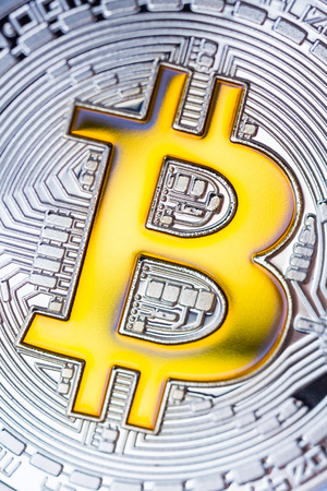 silver background: Silver bitcoin cruptocurrency, yellow bitcoin. Can be used as background. High resolution photo.