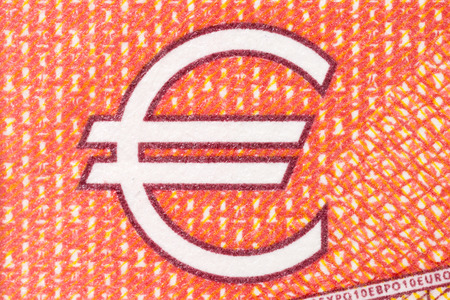 dept: Euro symbol on red background. High resolution photo.