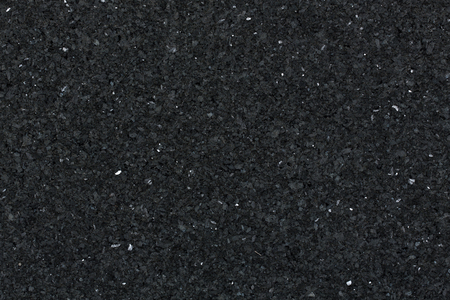 Black granite texture for backgrounds and overlays. High resolution photo.