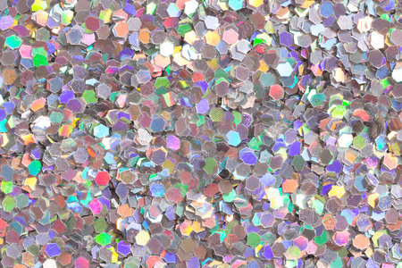Bright colourful background with glitter confetti. High resolution photo.