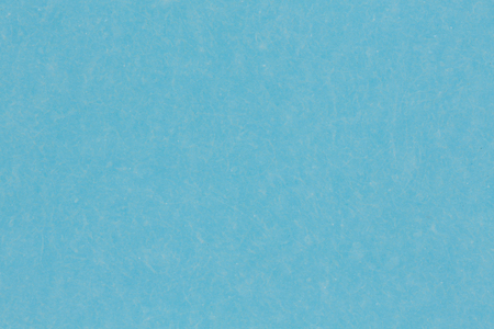Close up of light blue paper background. High resolution photo.