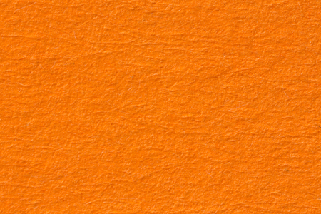 Orange paper background. Texture. High resolution photo. Фото со стока