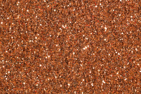 Light brown contrast background with glitter. High resolution photo.