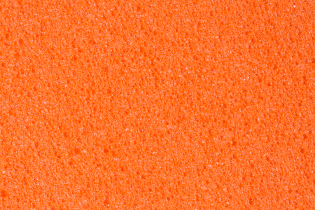 Effective saturated peach colour foam (EVA) texture. High resolution photo.
