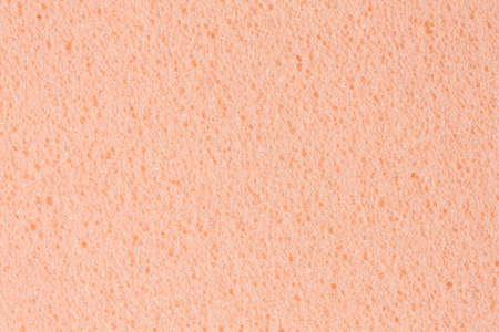 Simple gently pink ethylene vinyl acetate (foam) texture. High resolution photo.