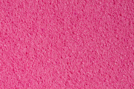 Simple pink ethylene vinyl acetate (foam) texture. High resolution photo.