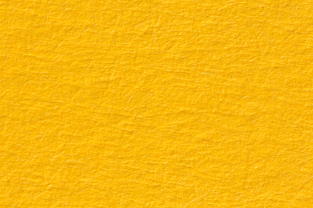 Yellow paper texture useful as a background. High resolution photo.