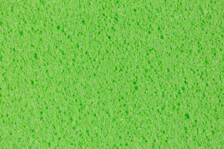 Lime green foam (EVA) texture with uneven surface. High resolution photo.