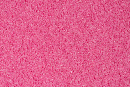 Porous dark pink ethylene vinyl acetate (foam) texture. Stock Photo