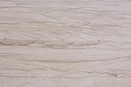 Close up of beige quartzite stone texture. High resolution photo.