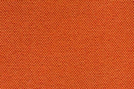 Shiny orange textile background for your stylish design. High resolution photo.