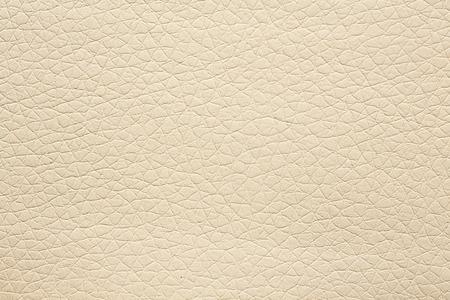 Gentle beige leatherette background. High resolution photo. Фото со стока