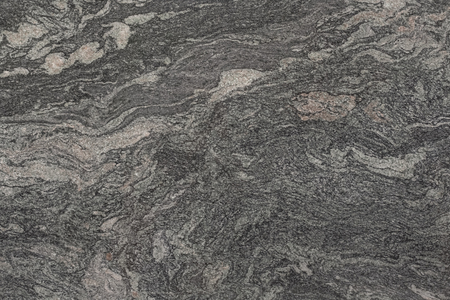 Natural dark grey granite background. High resolution photo.