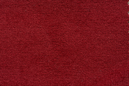 Contrast soft fabric texture in fascinating red colour. Stock Photo