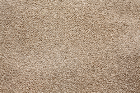 Fabric texture with soft beige surface.