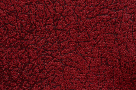 Relief textile background in admirable red colour. Stock Photo
