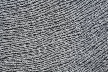 Material background in metalic grey tone.