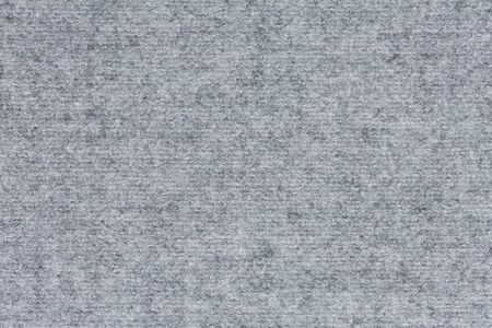 Unique light grey fabric background close up.