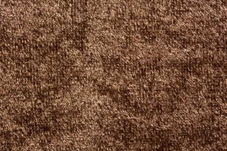 Extravagant textile background in stylish brown colour.