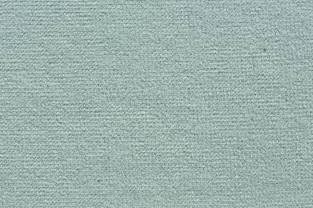 Gentle textile background in superior light blue tone.