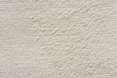Ordinary soft textile background in white colour. High resolution photo.
