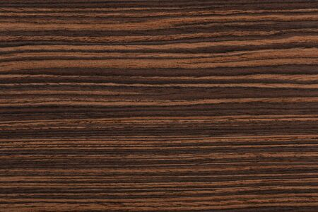 Beautiful natural ebony veneer background in brown color. High q