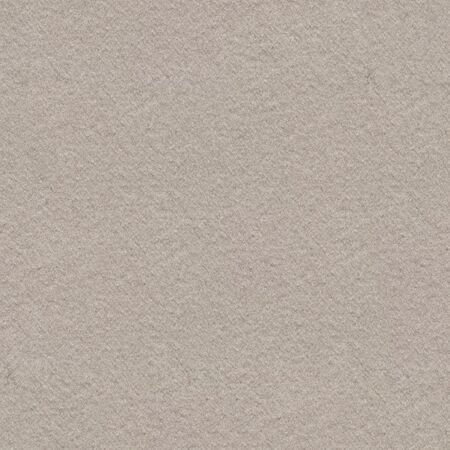 Fabric background in light beige tone.