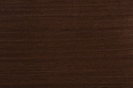 Dark brown venge veneer background as part of your new home project. High quality texture in extremely high resolution. 50 megapixels photo.