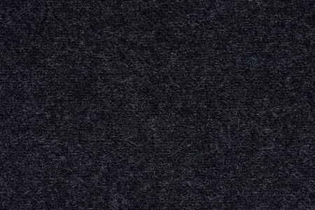 Soft grey textile background. Dark gray background.